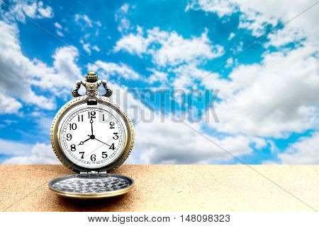 Luxury Vintage Golden Pocket Watch On Wooden Over Blue Sky With Cloudy Background, Abstract For Time
