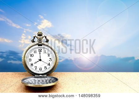 Luxury Vintage Golden Pocket Watch On Wooden Over Blue Sky With Cloudy And Sunrise Background, Abstr