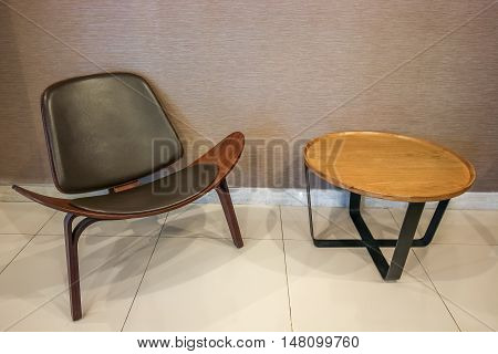 Luxury Style Chair Together With Wooden Round Side Table On Wall Background With Clipping Path