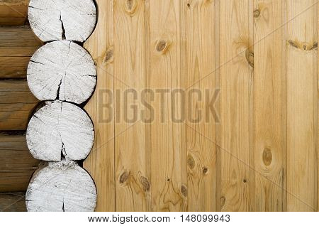 Wooden country house wall background with painted white round timber ends
