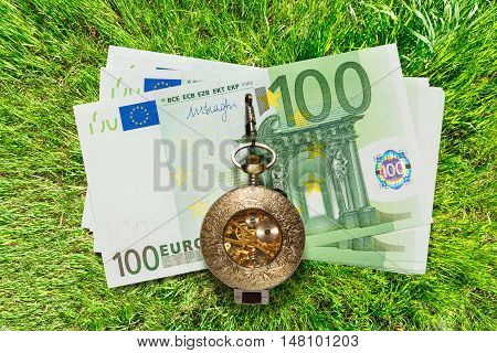 Euro Banknotes And Vintage Pocket Watch