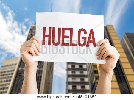 Strike (in Spanish) placard with urban background