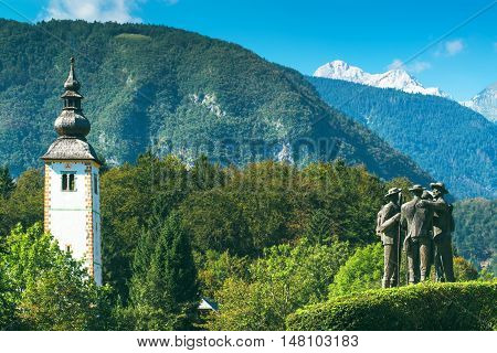 RIBCEV LAZ SLOVENIA - AUGUST 25 2016: Four brave men from Bohinj - the first men on Triglav. Statue of Bohinj natives that climbed highest mountain in Slovenia on August 26th in 1778.