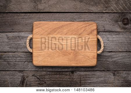 Chopping board on a rustic wooden table