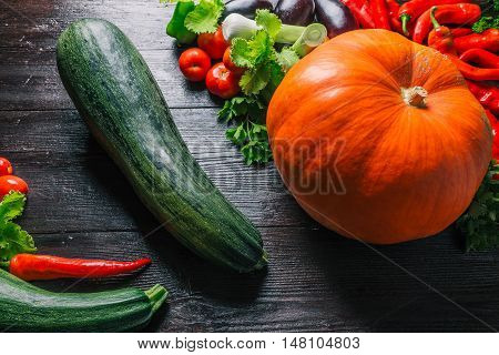 Variety of colorful fresh summer and autumn vegetables on the table