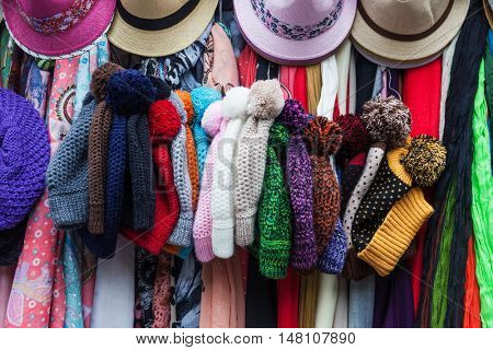 peruvian hats and scarves on a street market