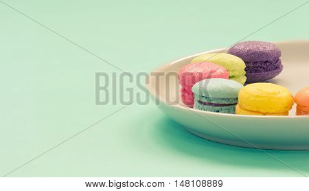 A colorful macaron- french dessert ,closeup and focused blue macaron