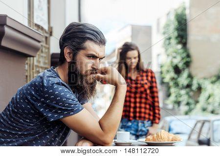 Unhappy Man In Cafe