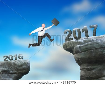 Businessman jumps to The New Year 2017. It is new challenge for your business. Happy New Year for all.