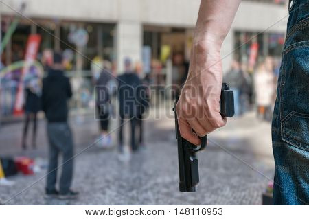 Armed Man (attacker) Holds Pistol In Public Place. Many People O