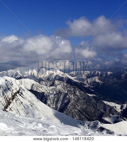 Sunlit Mountains In Clouds, View From Off-piste Slope