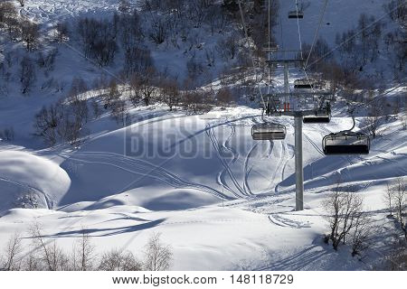 Chair-lift And Off-piste Slope In Winter Day
