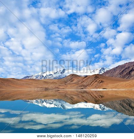 Mountains reflection in Thatsang Karu lake in the Indian Himalayas Ladakh Jammu and Kashmir state North India