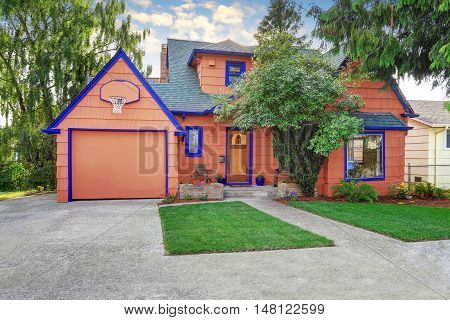 Coral Exterior American House With Blue Trim With Garage.