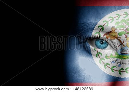 A young female with the flag of Belize painted on her face on her way to a sporting event to show her support.