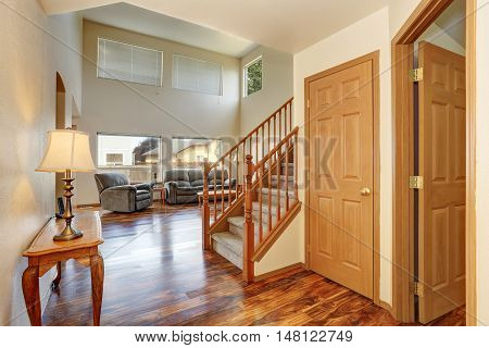 Classic Hallway Interior With Hardwood Floor. View Of Stairs To Second Floor