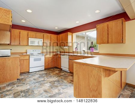Classic Kitchen Room Interior With Tile Floor And Wooden Cabinets