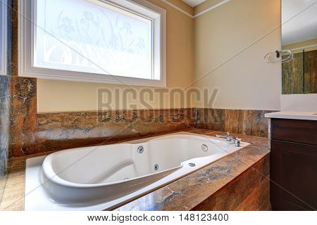 Luxury Bathroom Interior With White Bath Tub With Marble Trim