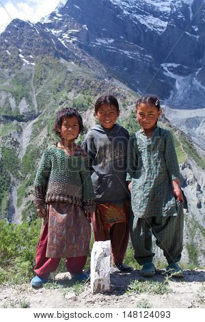 LADAKH, INDIA - JUNE 9, 2012: Villagers children poses for a photo on the road from Manali to Leh in Ladakh