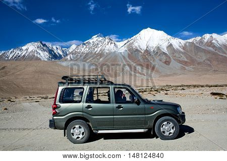 LADAKH, INDIA - JUNE 16: Off-road vehicle driving in the Indian Himalayas on June 16, 2012 in Jammu and Kashmir state, North India