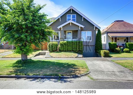 Classic American House Exterior With Siding Trim And Well Kept Garden.