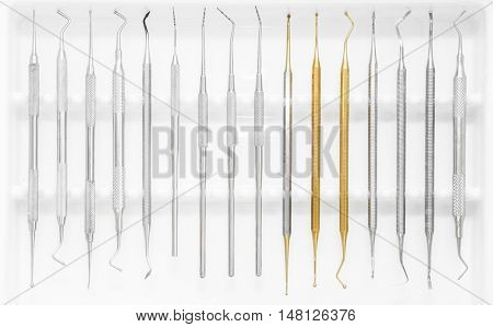 Tools for dental treatment on white background