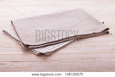 Napkin. Cloth napkin on white wooden background. Top view, mock up.