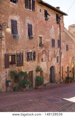 Beautiful ancient street in hillside Tuscan village