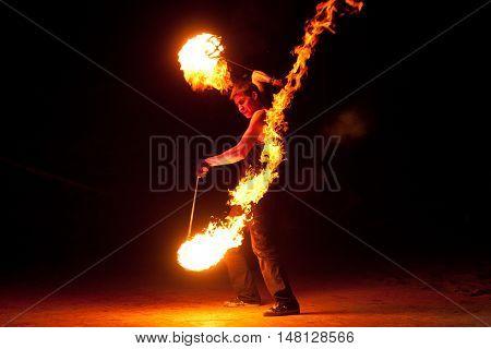 RUSSIA, BALTIYSK - JULY 06, 2014: The unknown artists demonstrate the fire show at the open festival «BALTIC FIRE FEST - 2014» on july 06, 2014 in Baltiysk, Kaliningrad region.