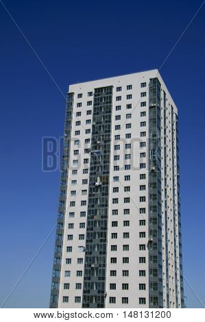 High-rise apartment building in front of the sunny sky