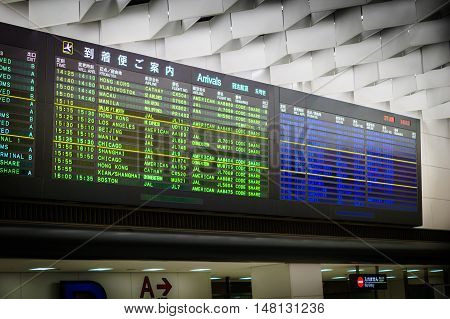 Tokyo, Japan - June 2016: Arrival / Departure timetable board at Narita International Airport, Japan. Narita Airport is one of the largest and busiest airport in Asia.