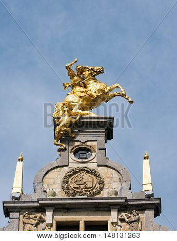 Statue of Saint George or Sint Joris and the dragon on a former guild house at the Great Square or Grote Markt in Antwerp, Belgium