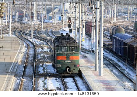 Electric locomotive in winter the hub of a big city