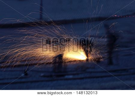 sparks from the metal work in the dark