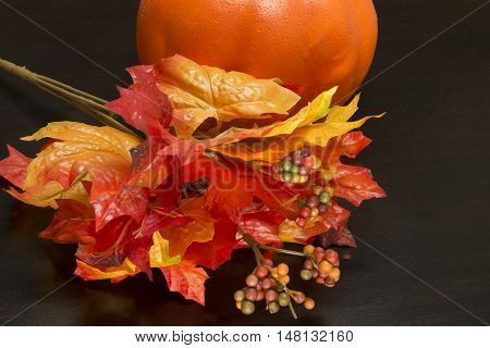 Colorful autumn decoration and orange pumpkin for the holidays