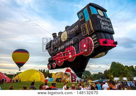 Ferrara Italy 16 September 2016 - A Special Shapes hot air baloon inspired by the famous Orient Express train at the Ferrara Balloons Festival