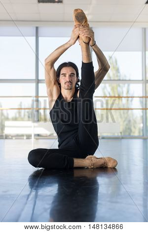 Young Male Ballet Dancer Sit On Floor Stretching, Man Practicing In Dance Studio