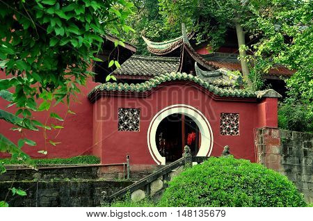 Langzhong Ancient City China - October 22 2013: A classic Chinese moongate leads to the tomb of the revered ruler Zhangfei at the historic Huanzhou Temple