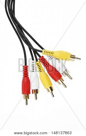 Plugs and cables on plain background