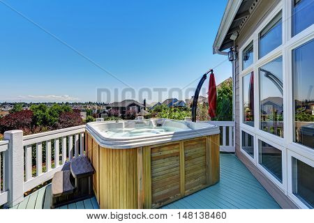 Close-up Of Wooden Hot Tub. Luxury House Exterior.