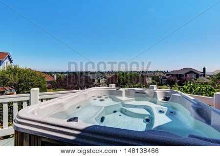 Close-up Of Hot Tub. Luxury House Exterior.