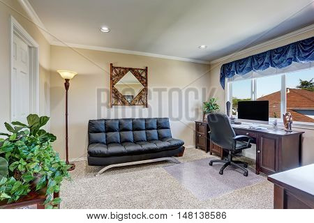 Luxury Interior Of Home Office With Black Leather Sofa