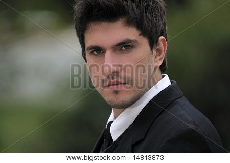 one young businessman face portrait outdoor