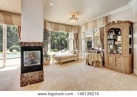 Large Master Bedroom Interior In Luxury Home With Sitting Room