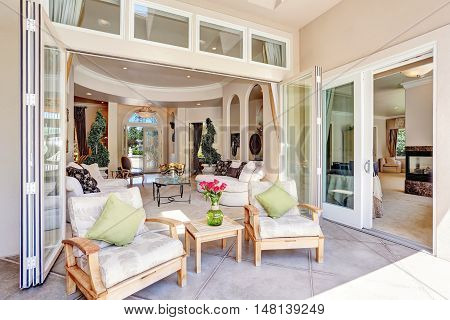 Relaxing Outdoor Seating Arrangement Of Luxury Mansion House.