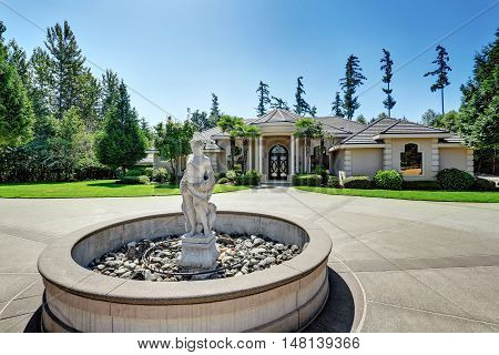 Suburban Luxury House With Fountain Statue In The Front Yard