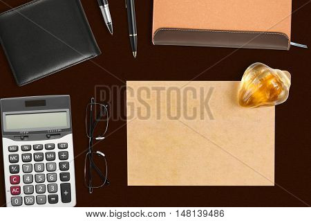 recycle paper note with paperweight & stationery on the desk