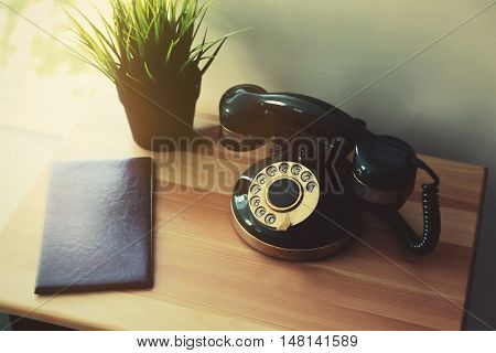 Old telephone on table in the room