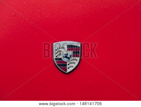 Moscow, Russia - September 10, 2016: Porsche sign on the red car hood