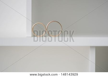 Two wedding rings on a white background. Mr. and Mrs